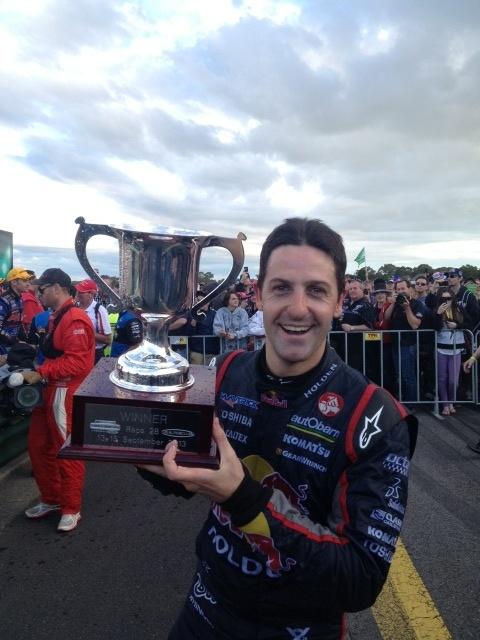 Sandown 500 2013 winner Jamie Whincup lifts his winning trophy